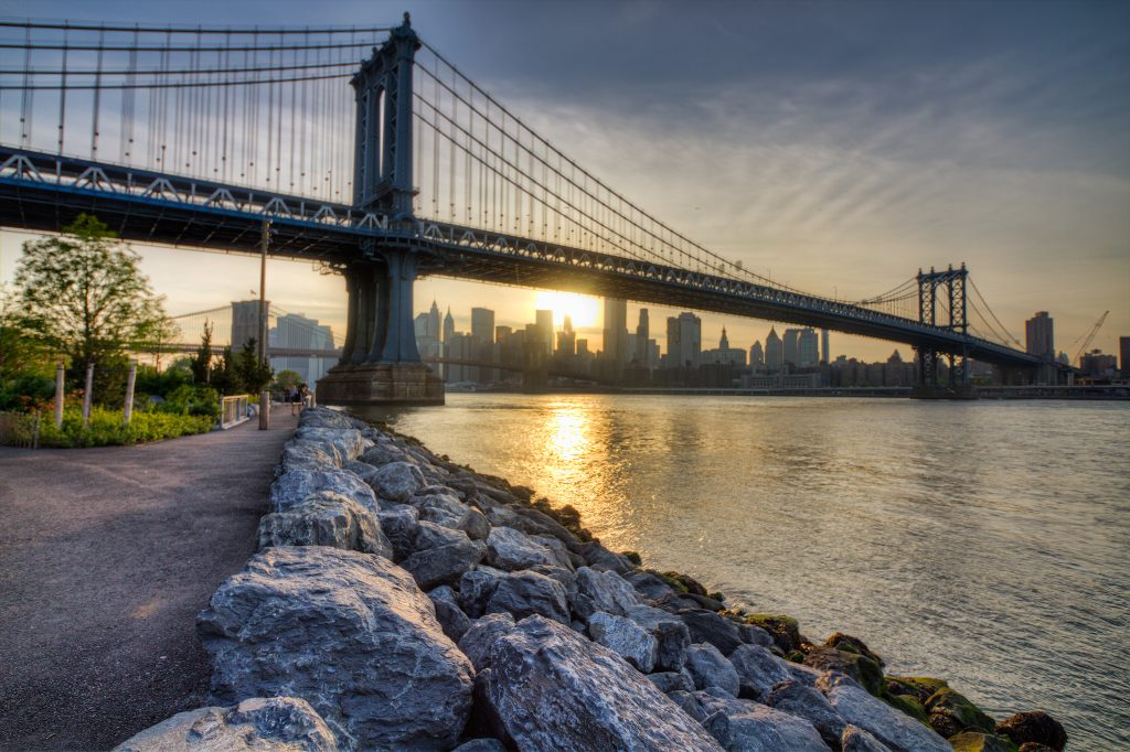 The Manhattan Bridge at Sunset, with the Brooklyn Bridge and the Manhattan skyline in the background.