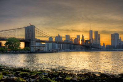 The Brooklyn Bridge at Sunset with the New York skyline in the background.  Also in the picture is Jane's Carousel.