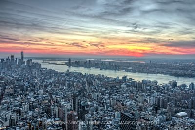 The sun setting over the island of Manhattan and New Jersey